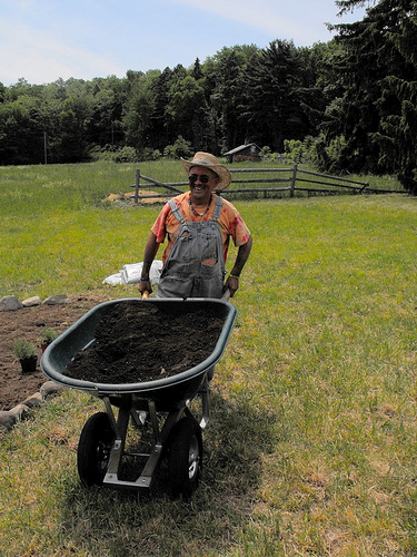 Paul Cardillo, Garden Designer of Medicine Wheel Gardens moving compost